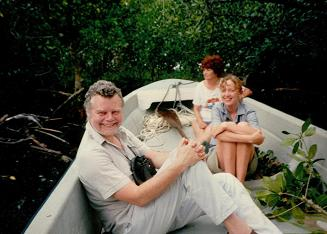 Jonathan Kingdom with Sophie Neville in Matthew Jebb's boat, Papua New Guinea