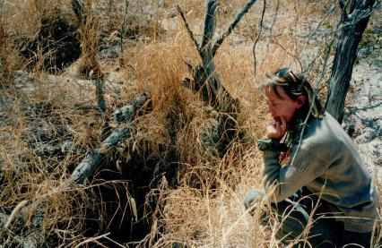 Sophie Neville looking at a Brown Heyena den in the Klahari