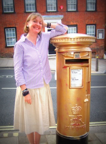 Sophie Neville with the gold pillar-box