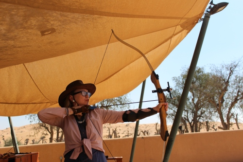 Sophie Neville shooting with a compound bow in the Emirates 2016.