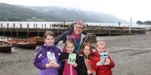 Sophie Neville with the Rushton children at the Marathon Reading of Swallows and Amazons