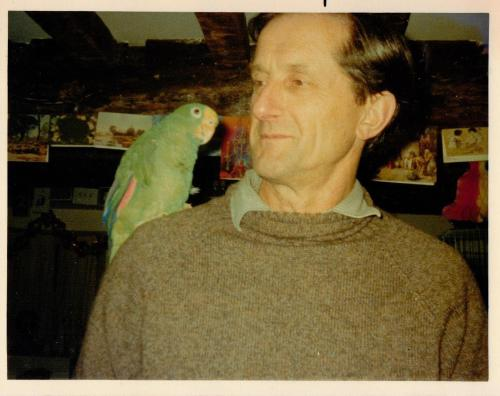 Roger Lee with our green parrot Chico