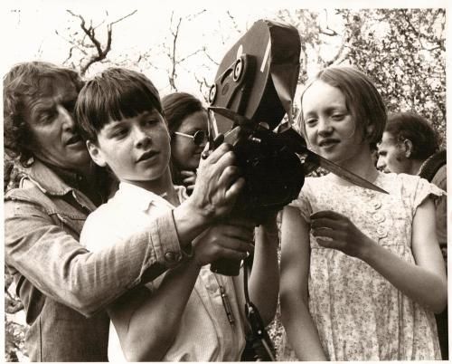 Claude Whatham showing the 16mm camera to Simon West and Sophie Neville. Sue Merry and Denis Lewiston.
