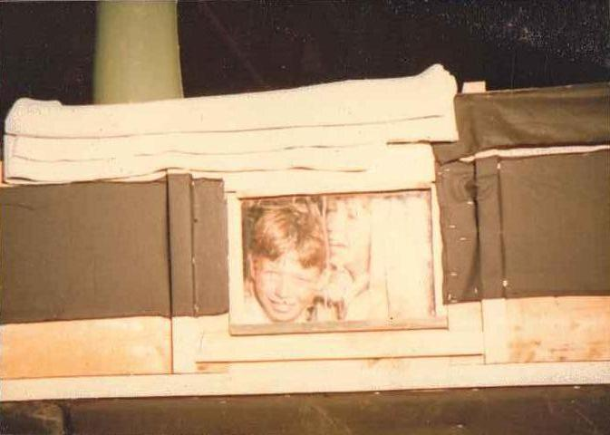 Nicholas Walpole and Jake Coppard looking out of the window of the set that was made to represent the interior of the Death and Glory
