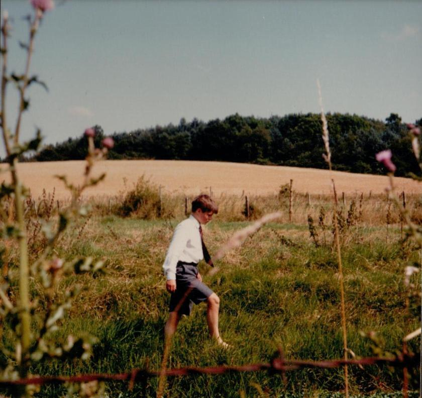 Richard Walton who played Dick Callum, walking barefoot in the field behind the station