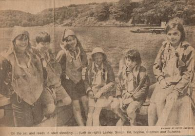 newspaper cutting of cast in life jackets