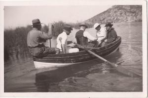 Possibly Arthur Ransome in bow of Peter Duck the boat he took to Syria