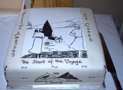 Cake depicting the book cover of Swallows Amazons and Coots