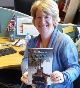Prize winner with her copy of 'The Making of Swallows and Amazons'